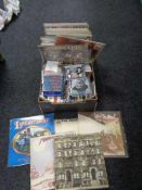 A box of CD's and vinyl LP's, The Beatles, Lindisfarne, Led Zeppelin,
