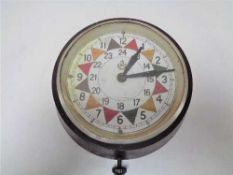 A Bakelite cased electric RAF style sector clock CONDITION REPORT: The dial is
