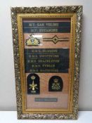 A gilt frame containing eight naval hat tallies together with four sew on badges