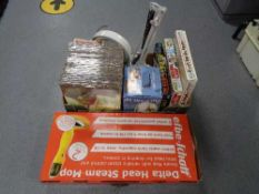 A boxed steam mop together with a further box of games, Clarke angle poise lamp,