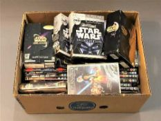A large quantity of Star Wars DVDs and VHS video tapes.