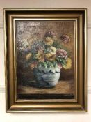 Continental School : Flowers in a vase, oil on canvas, framed.