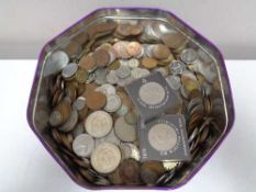 A tin of pre decimal coins and crowns