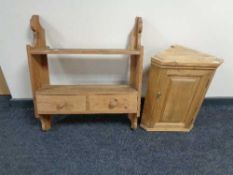 A pine wall shelf fitted with two drawers together with a small pine cabinet