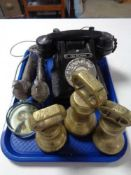 A tray of GPO black Bakelite telephone, three brass weights,