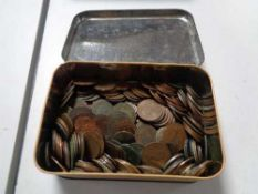 A vintage tin of coins,