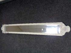 A contemporary framed narrow bevelled mirror