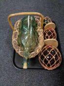 A tray of glass bottle in wicker basket,