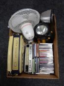 A box of torches, radios, CD's,