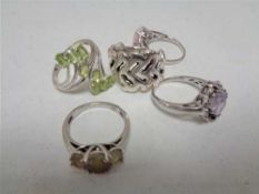 Five silver dress rings CONDITION REPORT: 3 size P, 1 size Q and 1 size S.