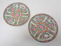 A pair of Chinese famille rose shallow dishes, width 21 cm.