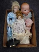 A box of four early twentieth century and later dolls