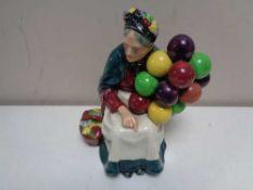 A Royal Doulton figure - The Old Balloon Seller HN 1315