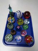 A tray of glass paperweights,