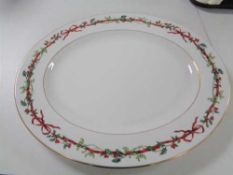 A Royal Worcester Holly ribbons meat plate