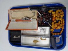 A tray of costume jewellery, beaded necklaces, crucifix, wrist watches,