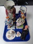 A tray of continental figurines, Toby jug, pottery figure,