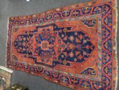 An antique Mahal rug, West Iran, 244 cm x 143 cm.