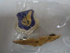 Two American badges, enamelled air force badge,