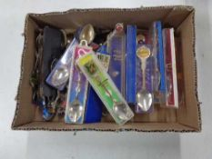 A box of crested teaspoons