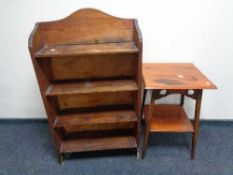 A set of early twentieth century pine bookshelves together with a two-tier Arts and Crafts