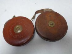 A vintage leather cased Chesterman tape measure together with one other