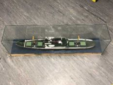 A large model ship behind glass, length 123cm.