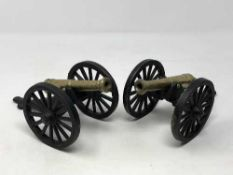 A pair of brass and metal cannons