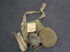 A box of WWII army cap, ration book,