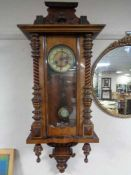 An early twentieth century mahogany cased eight day wall clock with brass and enamelled dial