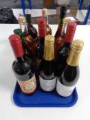 A tray of twelve bottles of alcohol and alcohol free mulled wines, apple juice,