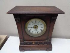 An Edwardian oak cased mantel clock with silvered and enamelled dial by Fattorini and Sons,