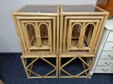 Two nests of three bamboo and wicker smoked glass topped tables and a further pair of side tables