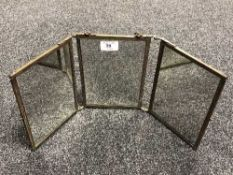 An early twentieth century brass three way table topped mirror, height 21 cm.