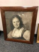 A monochrome print in a mahogany framed depicting a woman