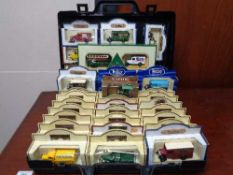 A plastic case of boxed die cast cars - Hamley's delivery vehicles,