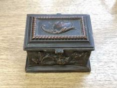 A miniature continental bronze ring casket, the panelled sides decorated with animals and birds,