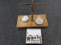 A set of chemist's micro balance scales together with a boxed set of weights