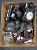 A box of retro style telephone, large quantity of cameras, Canon Eos 100, lenses and accessories,