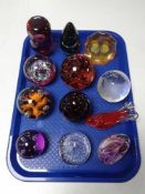 A tray of glass paperweights