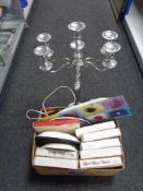A large metal five way candelabrum together with a box of wall light,