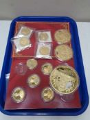 A tray of twelve gold plated commemorative coins,