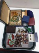 A tray of costume jewellery, beaded necklaces, gent's cufflinks, brooches,