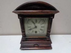 An early twentieth century HAC stained pine eight day mantel clock with silvered dial