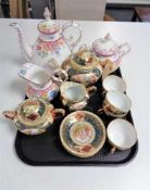 A tray of continental gilded eleven piece tea service, antique floral patterned teapot,