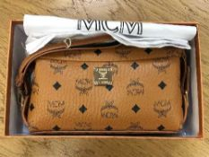 A lady's MCM hand bag in box with receipt and dust cover