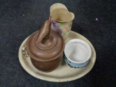 A large pottery meat dish together with Arthur wood vase,
