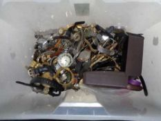 A box of lady's and gent's wrist watches,