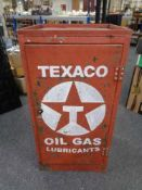 A mid century metal work shop cabinet fitted with shelves with Texaco hand painted decoration