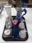 A tray of glass, quartz mantel clock, paper weight, dolphin figures,